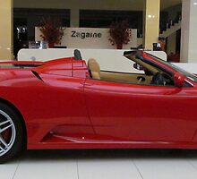 A Red Ferrari Convertable by Paul Campbell Psychology