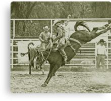 Cowboy Rides a High Kicking Bronco Canvas Print