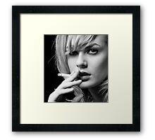 Portrait of Blonde woman smoking Framed Print