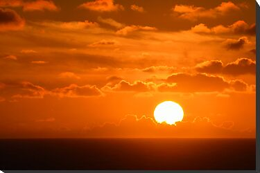 Sunset over ocean off coast of Spain by Steve