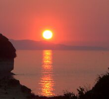 sundown in sidari by mocadbird