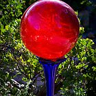 Red Bubble on a Blue Glass Pedestal by Mark Ramstead