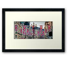 UK. London. Regent Street. Union Jack decorations for Royal Wedding. Framed Print