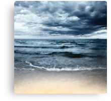 Sandy beach at stormy day. Dramatic sky Canvas Print