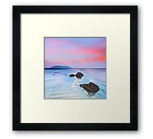 Sunrise over the sea. Stone on the foreground Framed Print