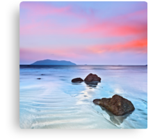 Sunrise over the sea. Stone on the foreground Canvas Print