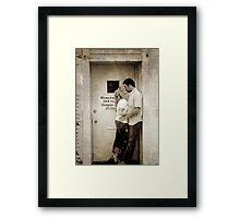 Kiss in the Doorway Framed Print