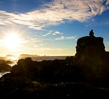 Sitting down for the sunrise - Ucluelet, British Columbia by Phil McComiskey