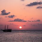 Cozumel Sunset with Pirate Ship by Bauerphoto