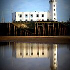 Scarborough Lighthouse in reflection by Tony Worrall