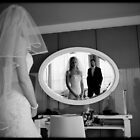wedding couple in mirror by beanphoto