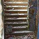 Debris On The Basement Stairs by Paul Budge