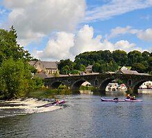 canoes on the weir at Graiguenamanagh, County Kilkenny, Ireland by Andrew Jones