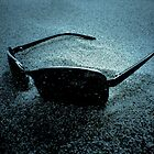 Sunglasses brushed in sandy winds. by Ravinder Surah