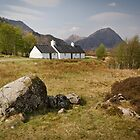 Blackrock Cottage Nestles in the Shadow of Buachaille Etive Mor by Bill Buchan