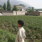 Pakistan- An Afghan boy  view the house of former al-Qaida leader Osama bin Laden by Adnan Ali Qureshi