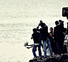 Bride's Escaping Into The Sea by Mojca Savicki