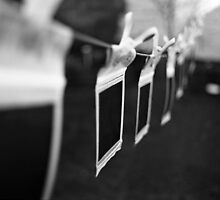Ten Little Polaroids Hanging On the Line by rorycobbe