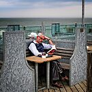 Quietly Reading, Southwold Pier, suffolk by Simon Duckworth
